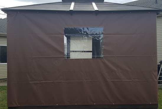 Brown gazebo tarp with windows