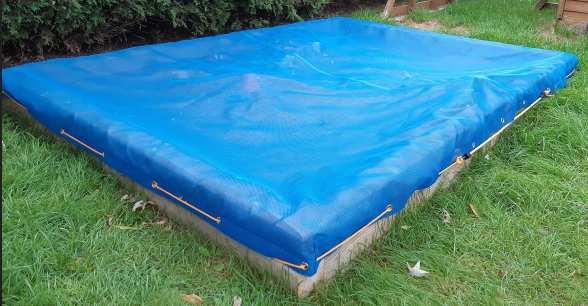 Mesh sandbox tarp