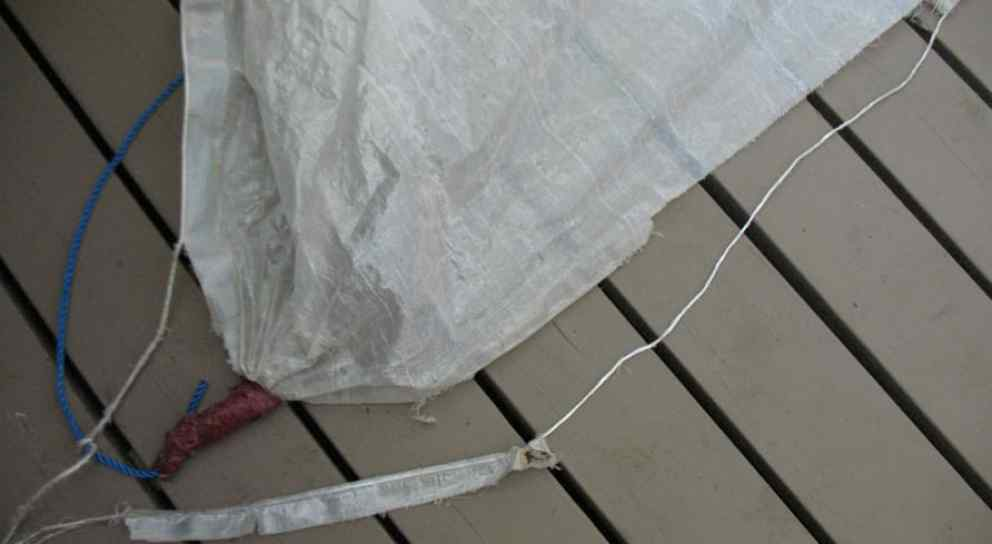 Cheap tarp with ripped edge