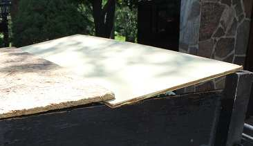 Boards used to cover utility trailer to prevent pooling
