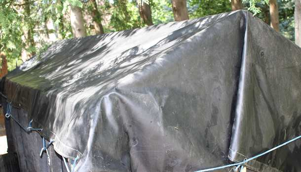 The tarp needs to be longer and wider to allow for raised center