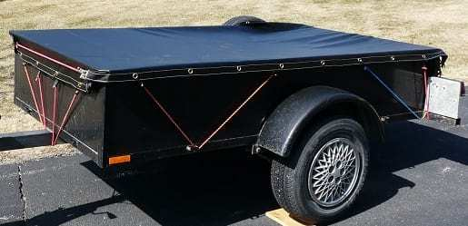 Utility trailer with 18 oz waterproof tarp