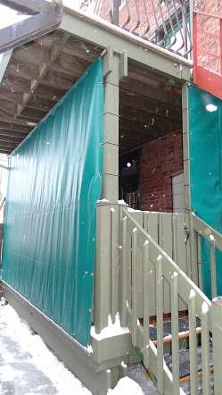 Tarp covering porch